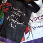 """Bag with """"Children's Books as a Radical Act"""" and """"Voice is a Revolution"""""""